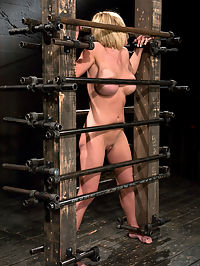 Krissy Lynn Big titted, blond, trapped in the ass big squeeze. : Trapped in a custom prison only 6 inches wide, Krissy Lynn feels the squeeze, unable to even turn her head.Her breast are pressed but her phat ass sticks out beautifully for whipping and hitting. Krissy is made to cum, made to suffer, tickled, and made to cum some more. Her emotions run the gambit and she is overwhelmed at one point. She collects herself and we move on, to more pain, more cumming.