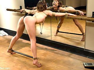 Yoga instructor Carries orgasms are streached to their limits... in the ass : Carrie is a yoga instructor who would never have imagined seeing herself in the ass studio mirror like this. Tied to her exercise bar and fucked with vibrating dildos and stretched with an ass hook, Carrie is taught a few new poses...