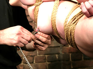 Starring Nina, Torque in the ass : Nina is back at the expert hands of Torque. First he places her in an uncomfortable tie over a barrel, and then tickles and torments her. Later he suspends her and finally he ties her in the ass corner with one leg high in the ass air.