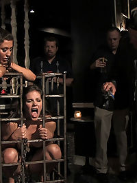 Bobbi Starr returns to Public Disgrace tits and ass : Locked in a cage Bobbi is rolled into a busy bar where patrons laugh nervously at her bound body. She is slowly undressed, made to cum, clamped, fondled and fucked. Her naked body is paraded around the bar and her mouth, pussy, tits and ass are fondled by strangers!