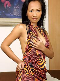 Asian dragon lady peels off her slinky tight dress
