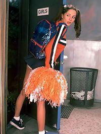 Teen cheerleader smokes in the girls room