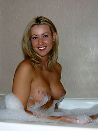 This blonde beauty is enjoying a frothy bubble bath