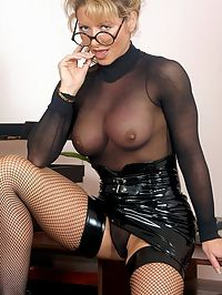 Prim mature chick with big tits wearing fishnet stockings