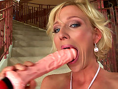 A horny blonde hottie using a big fucking dildo to cum