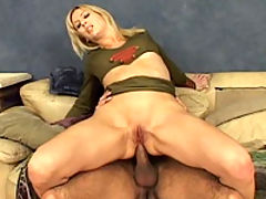 A busty blonde co ed getting ass fucked on a leather couch