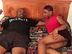 A big black man sticks it to his sexy ebony wife
