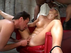 A chesty blonde bitch gets off on interracial DP action