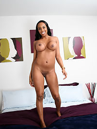 Kris is one lucky motherfucker! Any guy who gets to oil up and fuck an ebony goddess with 34 DD breasts definitely leads a charmed fucking life! But This black beauty has more going for her than just terrific titties, this bitch has a mouth built for pleasure and a snatch to match, both of which Kris fantastically fucks before dropping his massive man-load all over her jumbo jugs!