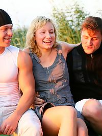 Outdoor teen threesome : Innocent blonde teen satisfy two guys outdoors
