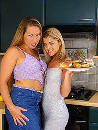Two young lesbians engaged in messy food play : The girls were doing some real cooking in the kitchen - but the oven wasnt even turned on! Things got real hot when the girls smeared cream all over each other and plugged themselves with a vibrator. These two horny teen lesbians really made their kitties purr with passion in the kitchen!