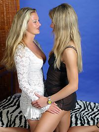 Two sexy lesbians undressing in bedroom