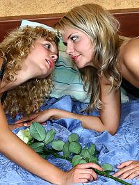 Two girls having fun in the bedroom