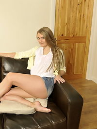 Pretty blonde teen masturbating on the couch