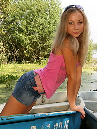 Sweet teen touching her shaved pussy on the boat