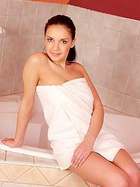 Sweet teen brunette masturbating in the shower