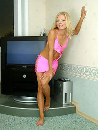 Blonde Russian babe in a sexy pink outfit