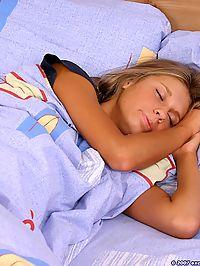 Cute blonde babe in her bedroom