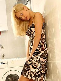 Horny teen removes panties in shower room