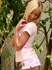 Hanna - Sexy Springtime : Adorable blonde teen coyly strips and spreads pussy by fence