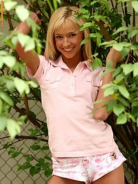 Hanna - Sexy Springtime : Blonde cutie coyly strips and spreads by fence in garden