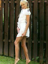 Hanna - Garden Flash : Blonde cutie flirtatiously undresses and poses in garden