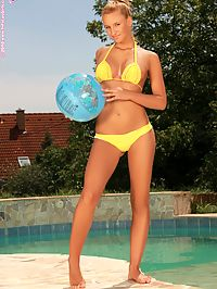Carmel - Wading Stroker : Blonde beauty strips and spreads her pussy by the poolside