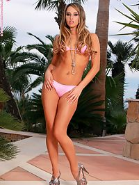 Alexia - Backyard Satisfaction : Dazzling siren drops bikini and fingers her sweet pussy