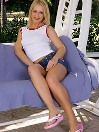 Vicki - Porch Swing : Lovely blonde dildos pussy and plugs ass in swing chair