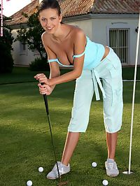 Juliette - Dildo Tee Off : Buxom brunette undresses and dildos her tight quim on green