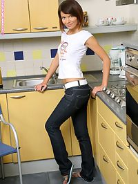 Era - Kitchen Naughtiness : Slender hottie works a gold vibrator into her tight ass