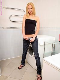 Bethany - Trickling Juices : Slim cutie nudes and dildos her pink pussy in the bathroom