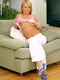 Kersti - White Pants : Beautiful teen nudes and plunges dildo into twat on couch