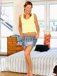 Eva - Hello Yellow : Freckled cutie undresses and enjoys yellow dildo in bed