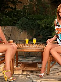 Nikitta and Rikki : Dazzling teens strip and tongue shaved pussies outdoors