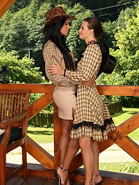 Ashley and Klara : Captivating brunettes undress and lap hot pussies on terrace