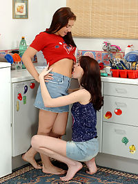 Jana and Michelle : Lovely teens get naked and strapon fuck pussies in kitchen