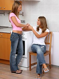 Alla and Natalia : Horny teens undress and strapon fuck pussies in kitchen