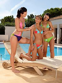 Paloma Charly and Andy : Sultry teen trio uses huge dildos and fists pussies poolside