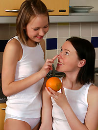 Cindy and Darlene : Petite lesbian teens finger for first time in the kitchen