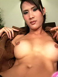 Sexy Asian shemale riding on a huge hard cock