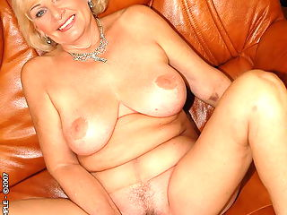 Elegant blonde granny toying and fucking hard