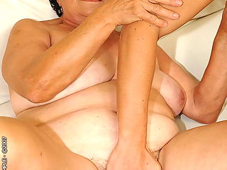 Puffy brunette grandma fucking with young guy