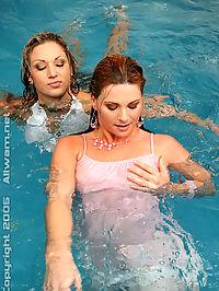 Two hot girls playing in pool wearing see thru clothing