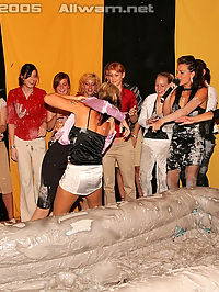 Lesbian babes getting freaky and dirty while mud wrestling
