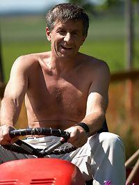 An old guy on a lawnmower fucks a hot bikini babe outdoors