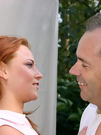 Sexy redhead babe fucks horny senior near their caravan