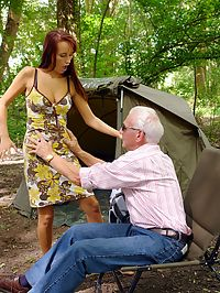 Redhead teen hottie seduces a wealthy senior on a camping