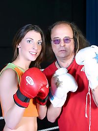 Old boxing trainer banging his teenage pupil in the ring