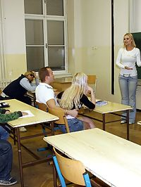 Cute teenager in jizzed on her face in a classroom by guys